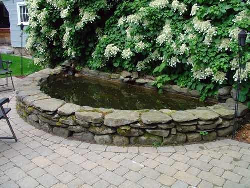 Stone wall designs retaining wall builders for Rock wall garden designs