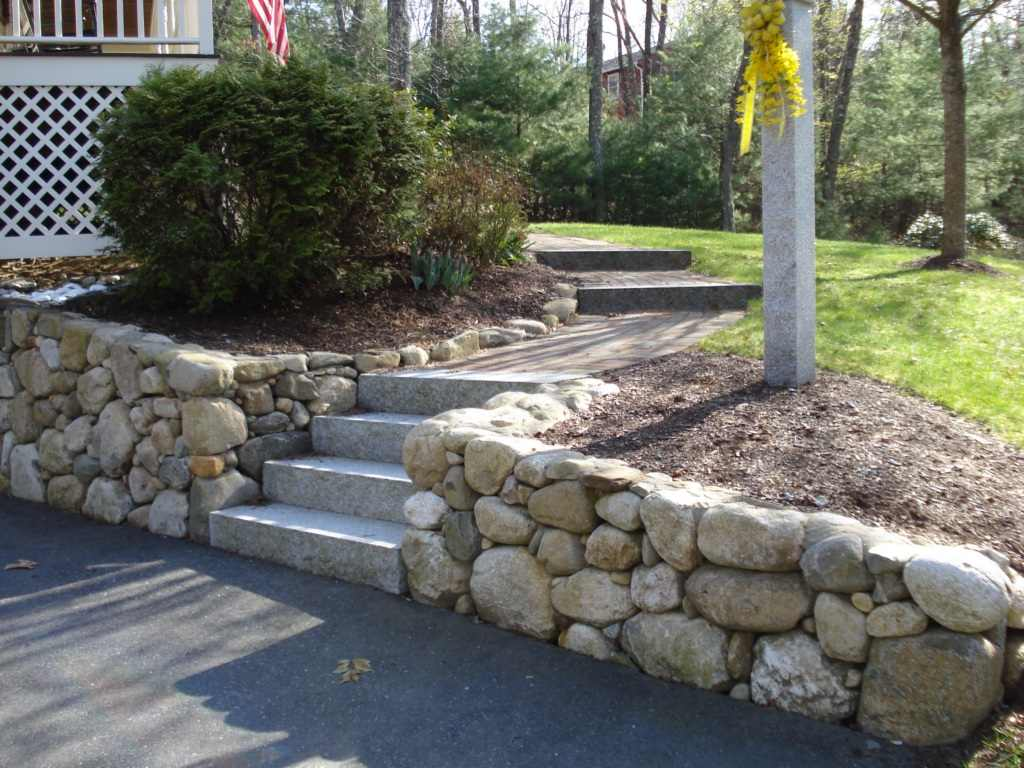 Stone wall projects 3 photos retaining wall installation for Stone landscaping ideas